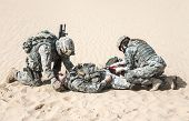 United States paratroopers airborne infantrymen in the desert rescuing their brother poster