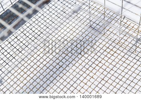 Old and weathered metal net with rust as background
