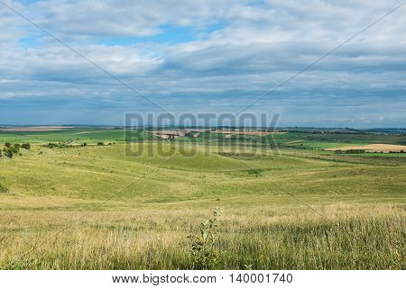 Summer landscape, a spacious yellow field and sky with clouds in Ukraine