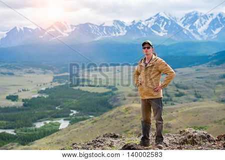 male traveler on a background of mountain