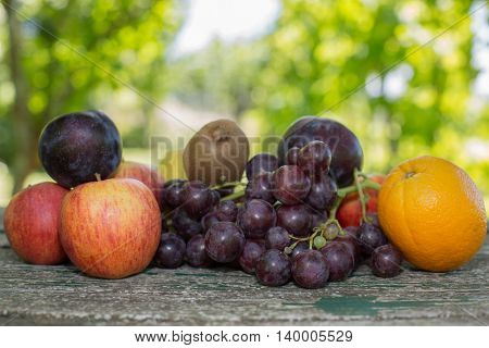 fruits in wooden table, outdoor