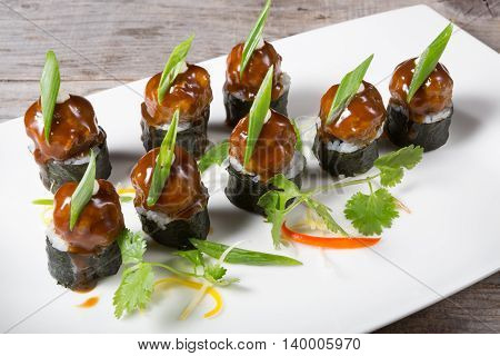 Asian styled meatballs served on a white plate