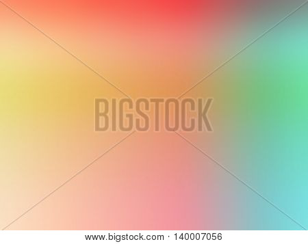 Abstract gradient rainbow orange green yellow colored blurred background.