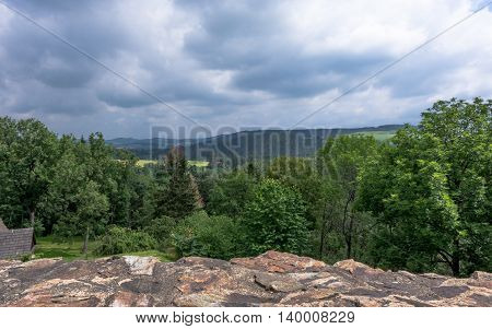 Forest around Velhartice castle - landscape picture with dramatic cloudy sky