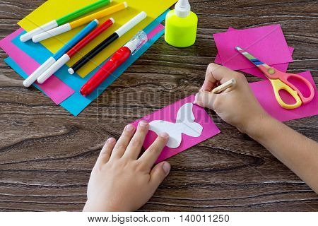 The Child Makes Decoration Paper Paper Butterfly In A Glass. The Child Draws Paper Of The Product. G