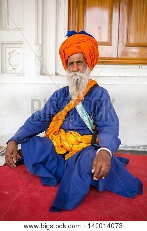 Amritsar, India - March 29, 2016: Portrait of Indian sikh man in turban with bushy beard in Golden temple in Amritsar, India.