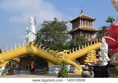 Binh Duong Vietnam June 16 2016: big statue of Bodhisattva and golden dragon at Buddhist Chau Thoi temple