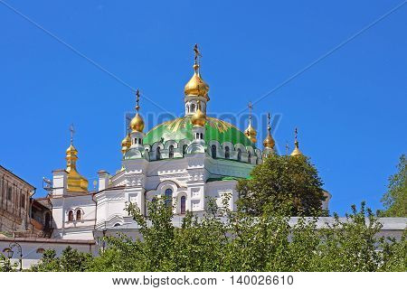 Orthodox domes with golden crosses of the Refectory church and the Assumption cathedral of Kyiv Pechersk Orthodox monastery in Kyiv, Ukraine