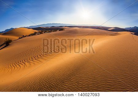 Gentle ripples on sand dunes. Hot and windy morning in the desert. Hot autumn in Death Valley, California