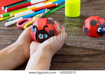 Colorful Paper For Children Handmade Odd Job Ladybug On A Blue Wooden Background. School And Kinderg