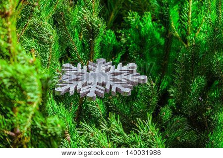 Christmas decoration. Large silver decorative snowflake pine branches.
