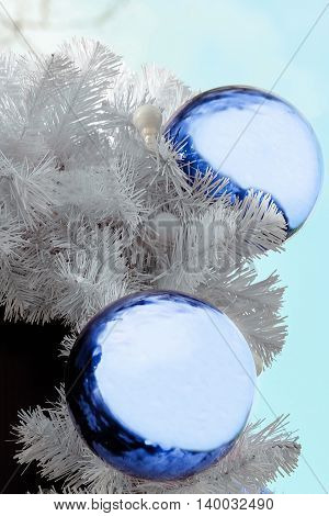 Background with light blue Christmas balls. Decorations.
