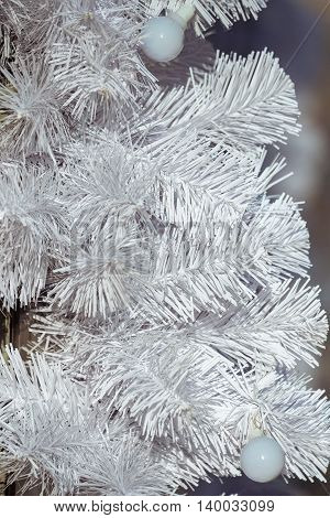 Bright Christmas background with artificial bright white spruce
