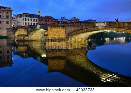 FLORENCE, ITALY - APRIL 27: Ponte Santa Trinita bridge over the Arno River shown on April 27, 2013 in Florence, Italy. The Ponte Santa Trinita is the oldest elliptic arch bridge in the world