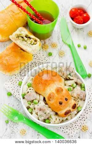 Snack patties stuffed with green peas and egg for baby dining meal. Patty in the form of animal hippo