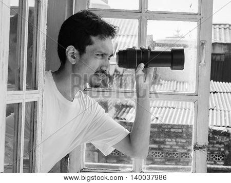 Man Spying Using Telephoto Lens
