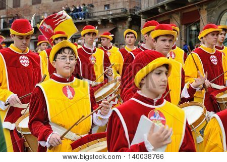 SIENA, ITALY - APRIL 28: The contrada of Valdimontone (Valley of the Ram) parade through the streets of Siena in preparation for the Palio April 28, 2013 in Siena, Italy.