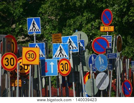 Lots of traffic signs in chaotic order Finland