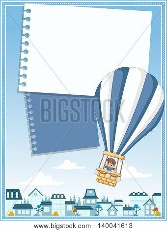 Card with cartoon baby boy inside a hot air balloon flying over a suburb neighborhood of a blue city.