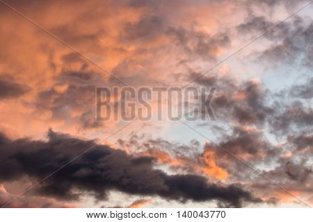 sunset afterglow on evening sky with dramatic clouds