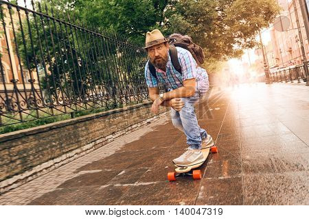 Man riding on longboard in the streets urban, setting of lifestyle concept