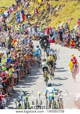 Col du Glandon France - July 23 2015: Group of favorites cyclists riding on the road to Col du Glandon in Alps during the stage 18 of Le Tour de France 2015.