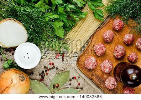 Cooking soup with meatballs or spaghetti with meatballs ingredients top view