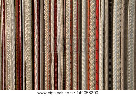 Gorgeous background of earth- tones, in several hanging braided ropes.