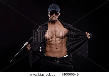 Conceptual photo of young sexy and good looking police officer