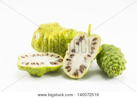 Noni and noni slice isolated on white background. Fruit for health and herb for healthy care.