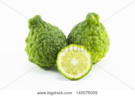 Kaffir lime and kaffir lime slice isolated is fruits and leaves are used as a spice for thai food and etc.
