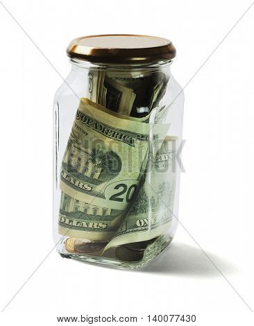US Dollars Bills and Coins in Glass Jar Lying on White Background