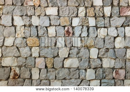 closeup of stone wall with grey and white stones