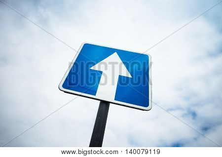 One Way Street, Blue Road Sign Over Sky Background