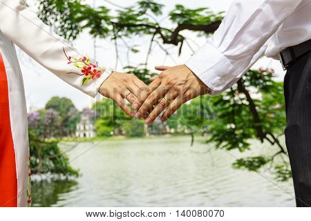 Wedding couple holding hands in Hanoi, Vietnam