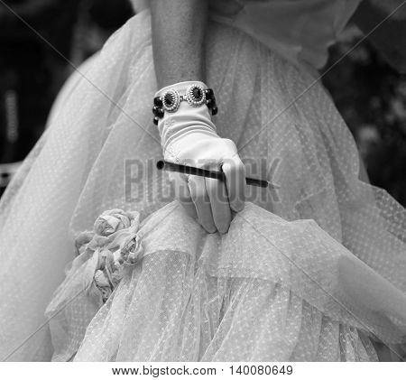 Gloved Hand On The Elegant Lady With The Cigarette Holder