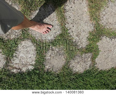 Barefoot Man Walking On The Ancient Roman Road