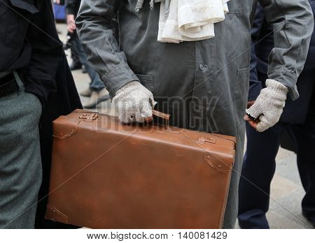 Poor Immigrant With Old Leather Suitcase During The Trip Abroad