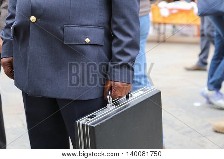 Cop With A Suitcase With Many Documents