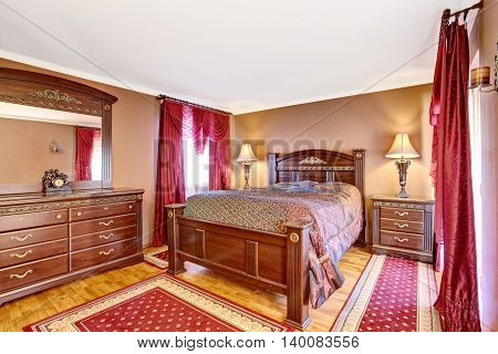 Vintage Bedroom Interior With Wooden Furniture, Red Curtains And Rugs.