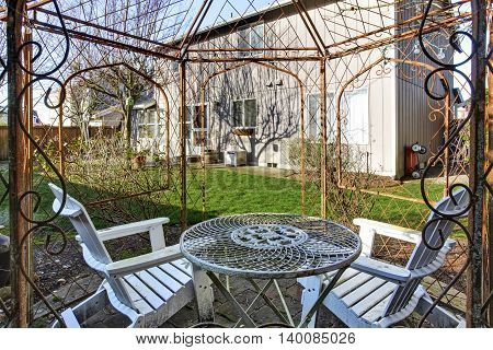 View Of Old Metal Gazebo In The Back Yard.