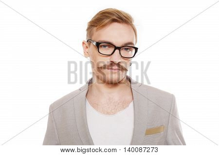 Young stylish blond man in beige blazer isolated at white. Portrait of confident guy looking at camera. Boy style, trendy male person in eyeglasses and black suit. Modern businessman.