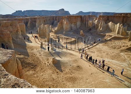 QESHM ISLAND, IRAN - Febrary 28, 2016: People walking through Stars Valley. Mountain range at Qeshm Island, Iran