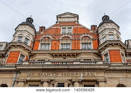 LONDON ENGLAND - JULY 1 2014: The entrance arch of St Mary's Hospital Paddington where Catherine Duchess of Cambridge gave birth on July 19 2013 of the future monarch.