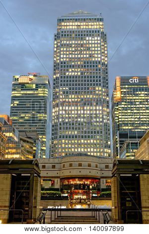 LONDON UK - JULY 1 2014: Some of the tallest skyscrapers in the Canary Wharf business district seen from Cabot Square at night.