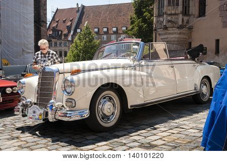 Nurnberg Bavaria / Germany - July 19th 2014: white vintage Mercedes Benz cabriolet at Sud - Rallye- Historic event in Nurnberg