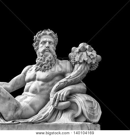 Marble statue of greek god with cornucopia in his hands isolated on black background with place for your text