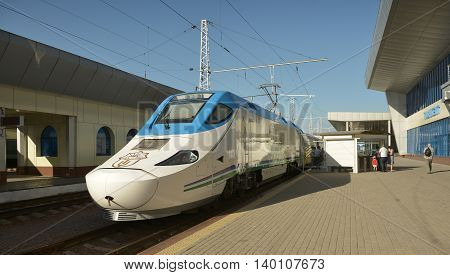 "Tashkent Uzbekistan - July 03 2014: Afrasiab is a high-speed train of the Spanish company ""Patentes Talgo S. L."". Operated on the line Tashkent - Samarkand - Karshi."