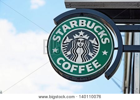 LONDON UK - JULY 1 2014: A logo of a Starbucks Coffee coffeehouse. Starbucks is the largest coffeehouse company in the world with 20891 stores in 62 countries (2013).