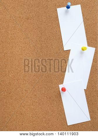 Cork Noticeboard With Three White Cards Pinned Vertically